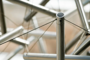 """Sixty Strut Tensegrity Sphere,"" a nine-foot diameter sculpture made of stainless steel tubing and wire"